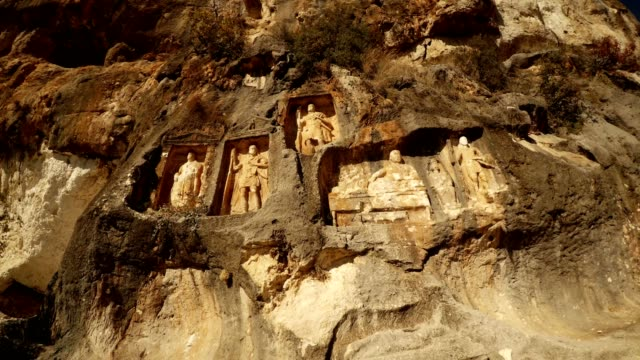 The Man Rocks figures in niches Adamkayalar Mersin province Turkey video