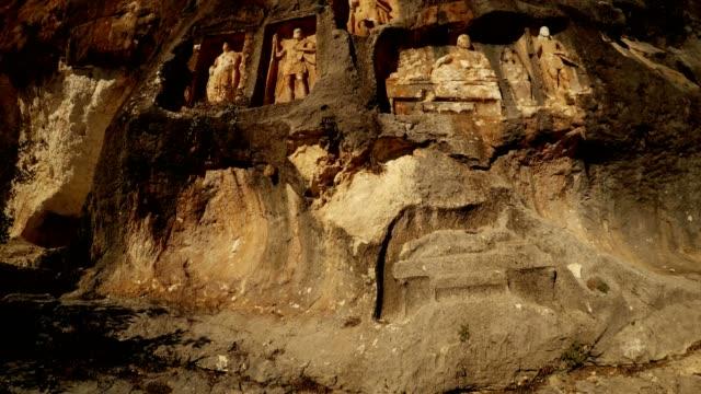 The Man Rocks figures in niches Adamkayalar Mersin province Turkey bottom view video