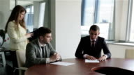 The management team at work. video