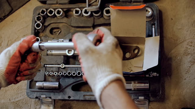 The mechanic selects the head for a wrench. video