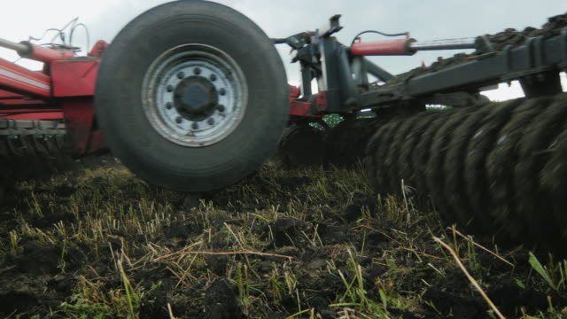 The mechanism for cultivating and plowing the land goes on the field video