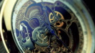 The mechanism of a wristwatch antique style. Macro video