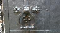 The metal knocker of the castles door video