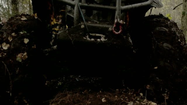 The muddy 4x4 offroad vehicle stuck in the muddy forest video