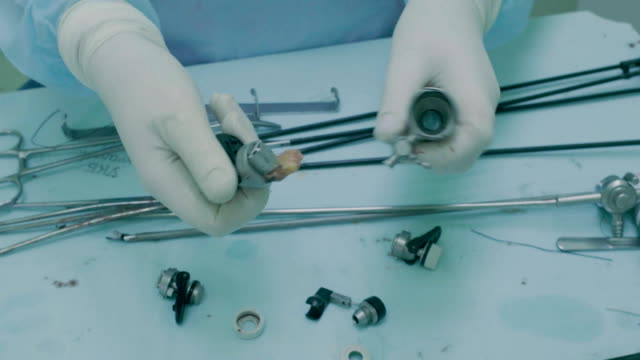 The nurse preparing medical instrument for washing video