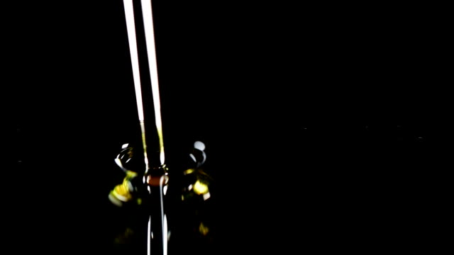 The oil flows on a black background video