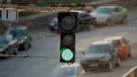 The old broken traffic light hangs on the wire above the road video