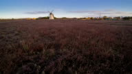 The old windmill in the middle of the field video