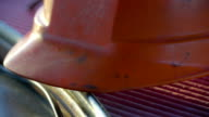 The orange hat for the factory workers video
