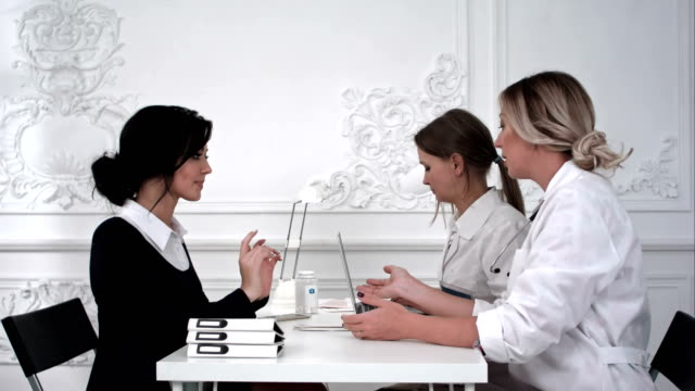 The patient pays for the treatment in the office video