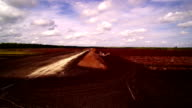 The peat field with flowers on the side video