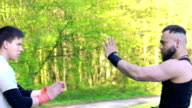 The performance of Wing Chun between master and follower on nature. Slowly video