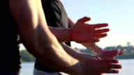 The performance of Wing Chun between masters near the river. Slowly video