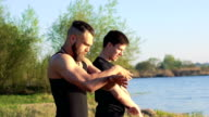 The performance of Wing Chun between strong men near river. Slowly video