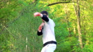 The performance of Wing Chun by boy on forest background. Slowly video
