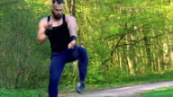 The performance of Wing Chun by master on forest background. Slowly video