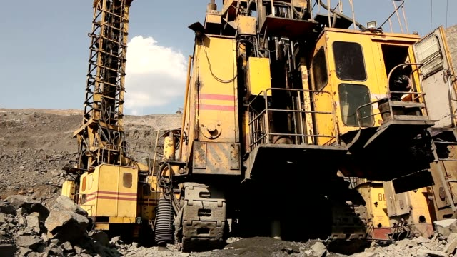 The pit drill panorama, Industrial drilling rig in a quarry, large drilling machine video