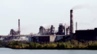 The plant at the river, heavy industry, the smoke from pipes video