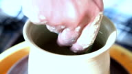The potter makes clay vessel video