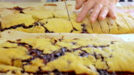 the preparation of 'tozzetti', typical Italian biscuits video
