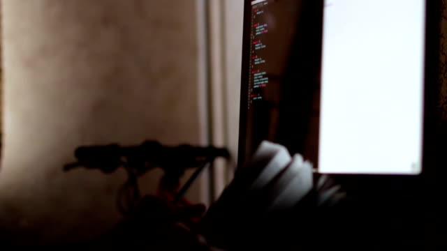 The programmer at work. The code of the website on the computer monitor video