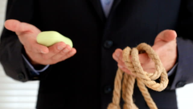 The provocation of suicide, men's hands show a rope and soap video