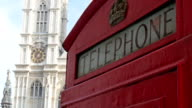 The red telephone booth fronting the St.Margarets church video
