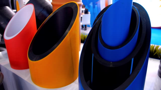 The row of plastic plumbing pipes of different diameter and different colors video