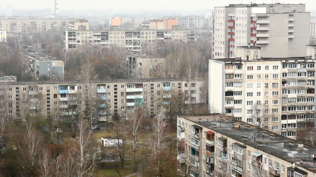 The same type of multi-storey buildings in the urban area. View from a height. video