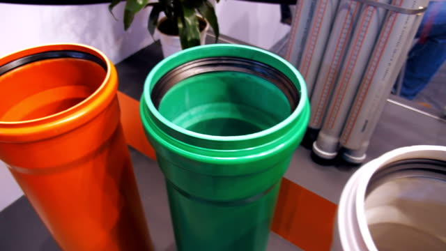 The samples of plastic plumbing pipes of different diameter and different colors video