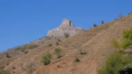 The sandy cliffs with rare green bushes. Crimea. Zelenogorie video