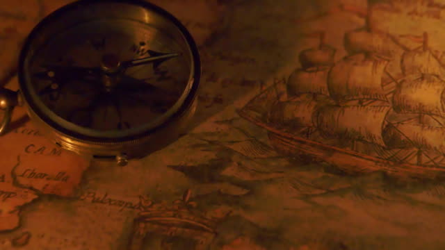 The shadow of the compass showing on the map video