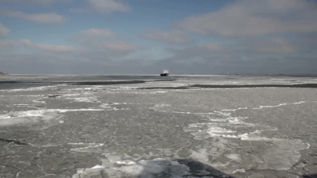 The ship is moving across the sea covered with ice video