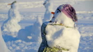 The sideview of the snowman in apron video