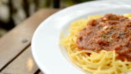 The spaghetti with tomato sauce, fried pork chops. video