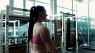The strong woman prepares for training video