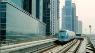 The subway train rides among the glass skyscrapers in Dubai, UAE video