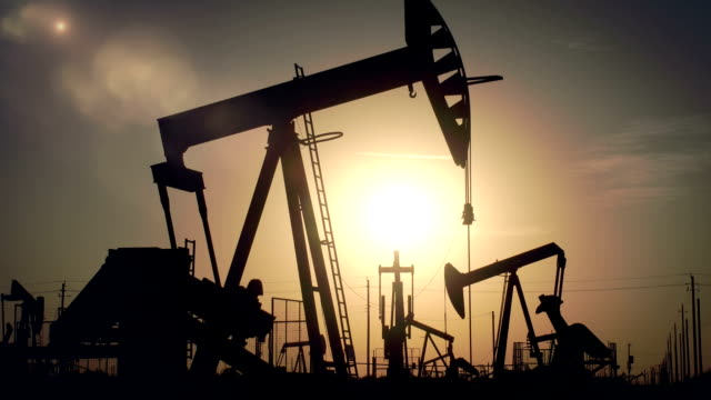 The Sun Rising Behind Oil Wells video