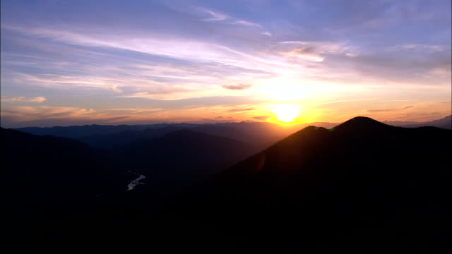 the Sun Sets Over Glacier Park  - Aerial View - Montana, Flathead County, United States video