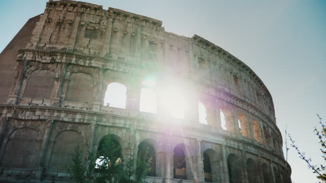 The sun sets over the famous collision in Rome. Sunlight through arches. Steadicam shot video