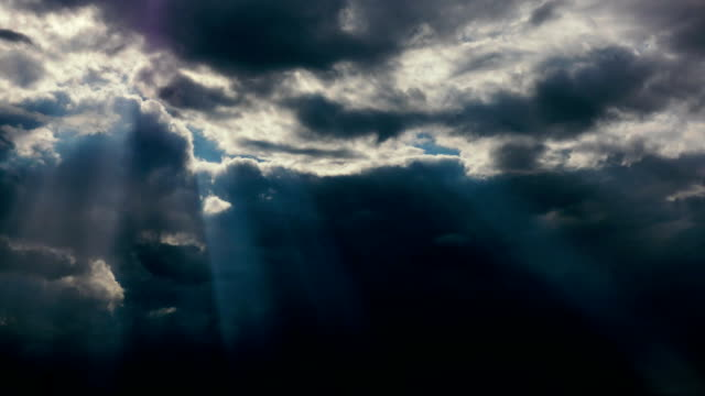 The sun's rays shine through the clouds video