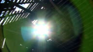The sun's rays shine through the leaky roof of the old house. video