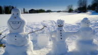 The three snowman in the ground with snow video