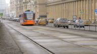 The tram rides along the street video