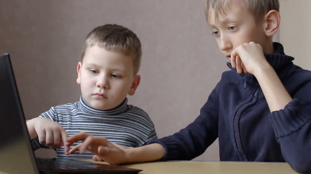 the two boys play in a computer game online video