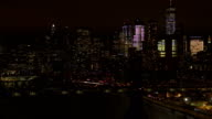 AERIAL: The two bridges lit up at night connecting Brooklyn & downtown Manhattan video