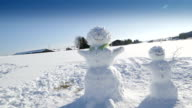 The two snowmen standing on the field video