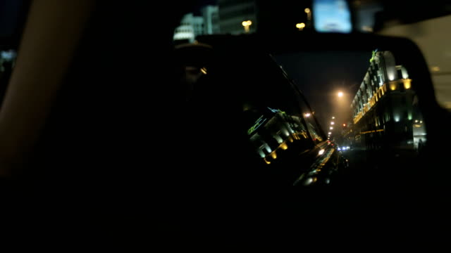 The view from the side mirror of the car. Night city. video