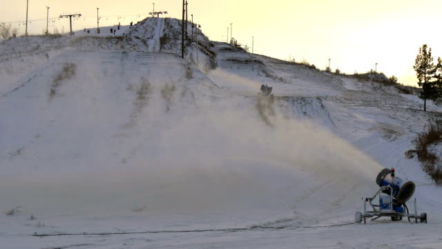 The view of the ski resort with the snowblower video