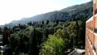 The view on mountains, cypress and olive trees in Corfu island, Greece video
